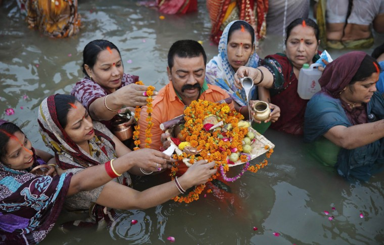 Hindu devotees perform religious rituals in the River Ganges to mark Chhath Puja festival in Allahabad, India, Wednesday, Nov. 18, 2015. During Chhath, an ancient Hindu festival, rituals are performed to thank the Sun god for sustaining life on earth. (AP Photo/Rajesh Kumar Singh)
