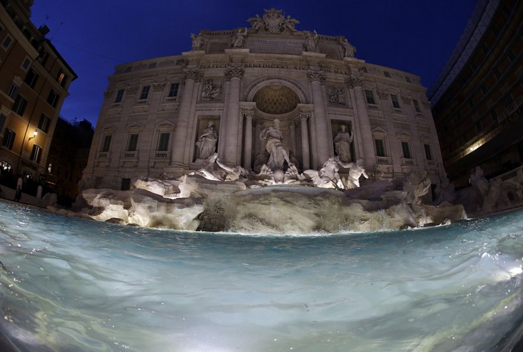 "The newly restored Trevi Fountain is lit during the official inauguration in Rome, Tuesday, Nov. 3, 2015. The historical fountain, famed as a setting for the film ""La Dolce Vita'' and the place where dreamers leave their coins, reopened after a 17-months restoration financed by the Fendi fashion house. (AP Photo/Gregorio Borgia)"