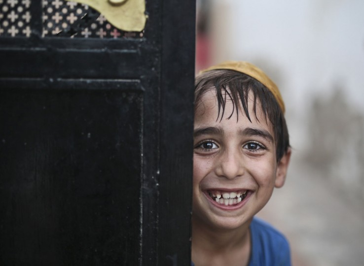 A student covering his head with a Kippah poses for the camera as he leaves the main Talmudic school at Hara Kbira, the main Jewish neighborhood on the Island of Djerba, southern Tunisia. Tunisiaís Jewish population has dwindled from 100,000 in 1956, when the country won independence from France, to less than 1,500, mainly as a result of emigration to France and Israel. But unlike in much of the rest of the Arab world, Tunisian Jews have seen little direct persecution and have only rarely been targeted by extremists. (AP Photo/Mosa'ab Elshamy)