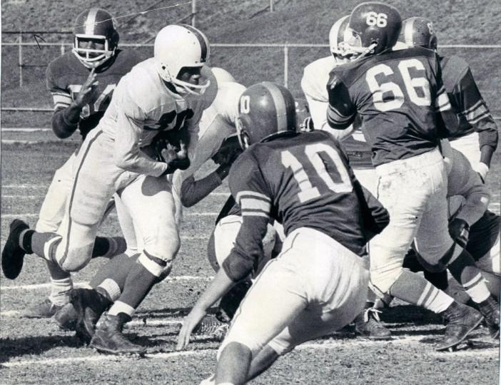 Charley Pittman, Edmondson's fullback, rips through Forest Park line for nice gain at Kirk Field. (Paul Hutchins/Baltimore Sun, 1964)