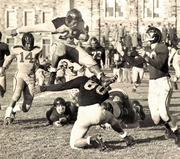 James Prince leaps for a gain. Dunbar versus Southern at City Field. (William Klender/Baltimore Sun, 1958)