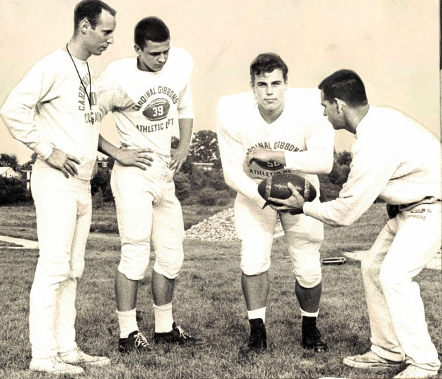 Backs on Gibbons squad, new member of B Division, receives instruction on handoffs. (Swagger/Baltimore Sun, 1964)