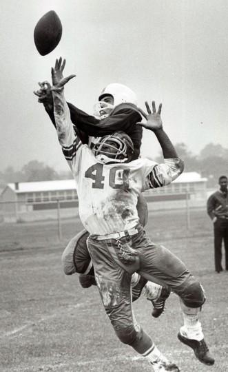 Carver's Howard Stevenson breaks up a pass intended for Edmondson's Bernie Smith. (Paul Hutchins/Baltimore Sun, 1964)
