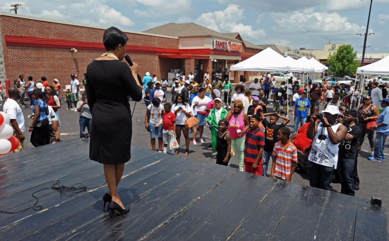 Baltimore Mayor Stephanie Rawlings-Blake met with residents during the community block party at the Cherry Hill Town Center after the Fourth annual Cherry Hill Prayer Walk on June 6, 2015. About 150 residents and supporters walked in the Fourth annual Cherry Hill Prayer Walk organized by Michael Battle. (Kenneth K. Lam/Baltimore Sun)