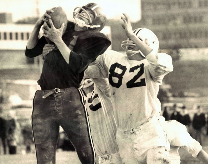 Woodlawn's Grover White pulls down a Kevin Hicks pass in front of Towson defender SKip Lichtfuss. (Paul Hutchins/Baltimore Sun, 1969)