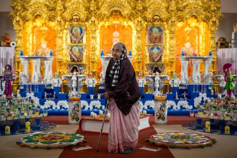 An elderly woman poses for a photograph at Shree Swaminarayan Mandir in Kingsbury during Diwali celebrations on November 11, 2015 in London, England. The Hindu festival of Diwali, the festival of lights, celebrates the triumph of good over evil and light over darkness. (Photo by Rob Stothard/Getty Images)