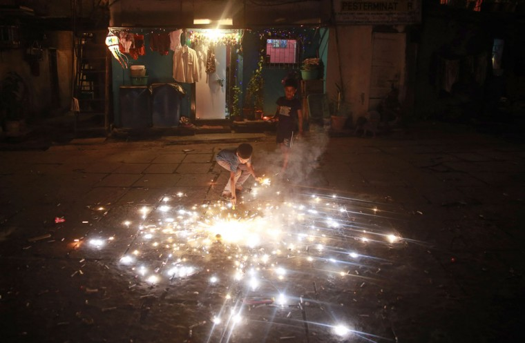 Children play with firecrackers to celebrate Diwali at a slum dwelling in Mumbai India, Wednesday, Nov. 11, 2015. Diwali, the festival of lights, is one of Hinduism's most important festivals dedicated to the worship of Lakshmi, the Hindu goddess of wealth. (AP Photo/Rafiq Maqbool)