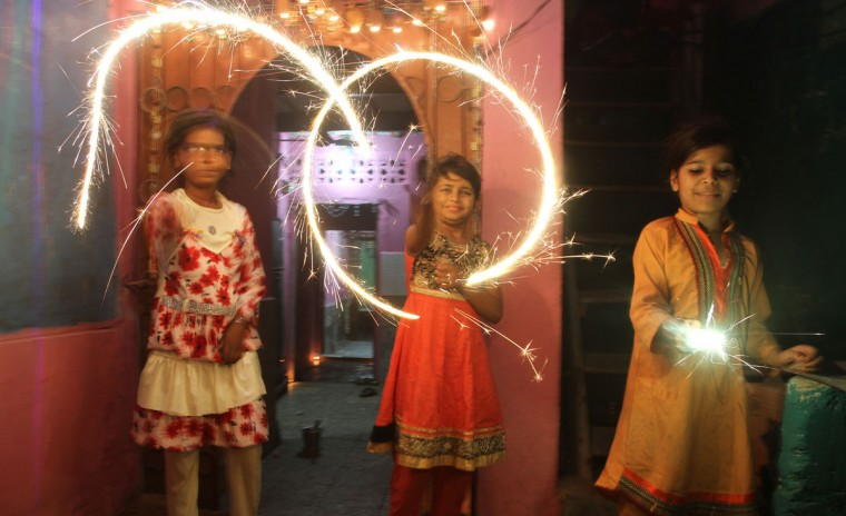 Pakistani children from Hindu communities celebrate the Diwali in Karachi, Pakistan, Wednesday, Nov. 11, 2015. Diwali, the festival of lights, is one of Hinduism's most important festivals dedicated to the worship of Lakshmi, the Hindu goddess of wealth. (AP Photo/Fareed Khan)