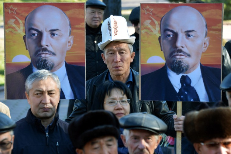 Kyrgyz Communist party supporters holds portraits of Soviet Union founder Vladimir Lenin during a rally to mark the 98th anniversary of Russia's Bolshevik Revolution in central Bishkek on November 7, 2015. (Vyacheslav Oseledko/AFP-Getty Images)