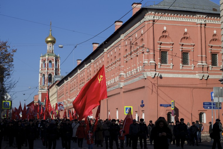 Russian Communists carry red flags during a demonstration marking the 98th anniversary of the Bolshevik revolution in Moscow, Russia, Saturday, Nov. 7, 2015. For decades Nov. 7 used to be a holiday celebrating the 1917 Bolshevik Revolution and which is no longer a public holiday in Russia. (AP Photo/Ivan Sekretarev)