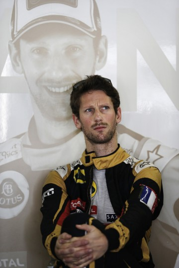 Lotus driver Romain Grosjean, of France, sits in pits during the third free practice for the Formula One Brazilian Grand Prix at the Interlagos race track in Sao Paulo, Brazil, Saturday, Nov. 14, 2015. (AP Photo/Silvia Izquierdo)