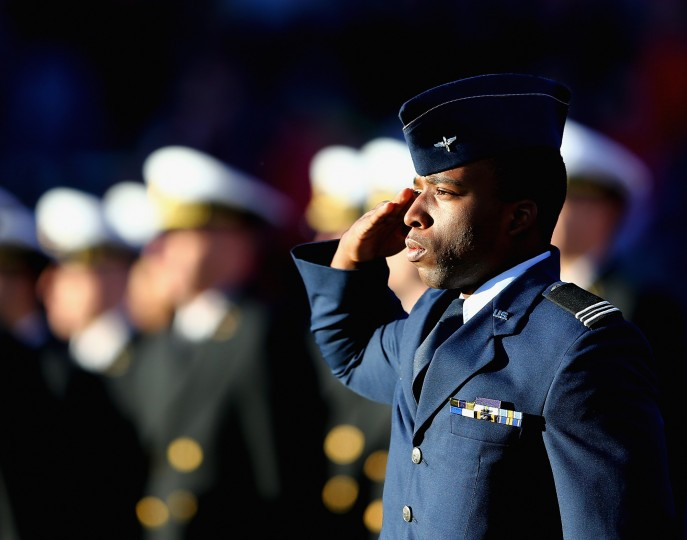 Military members attend the pregame ceremony for Military Appreciation Day before the game between the Rutgers Scarlet Knights and the Nebraska Cornhuskers on November 14, 2015 at High Point Solutions Stadium in Piscataway, New Jersey. (Photo by Elsa/Getty Images)