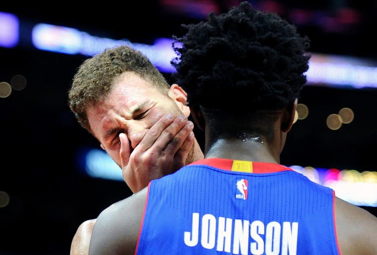The Los Angeles Clippers' Blake Griffin grimaces in pain in front of the Detroit Pistons' Stanley Johnson after getting hit in the mouth in the second period at Staples Center in Los Angeles on Saturday, Nov. 14, 2015. (Wally Skalij/Los Angeles Times/TNS)