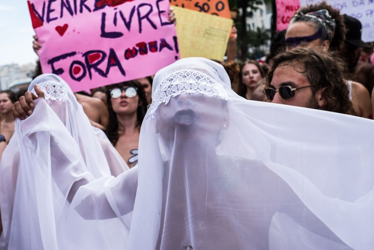 """Women take part in the """"Slutwalk"""" against the president of the Brazilian Chamber of Deputies Eduardo Cunha at Copacabana beach in Rio de Janeiro, Brazil on November 14, 2015. Cunha is an influential rightwing politician at the center of maneuvers to impeach Brazilian President Dilma Rousseff. (Christophe Simon/AFP-Getty Images)"""
