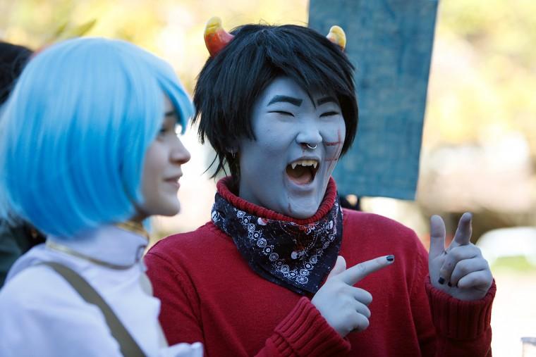 Car Alkov, 14 (left), and Dyre Lee, 15, joke during N.C. Comicon on Saturday, Nov. 14, 2015 in Durham, N.C. (Christine T. Nguyen/The Herald-Sun via AP)