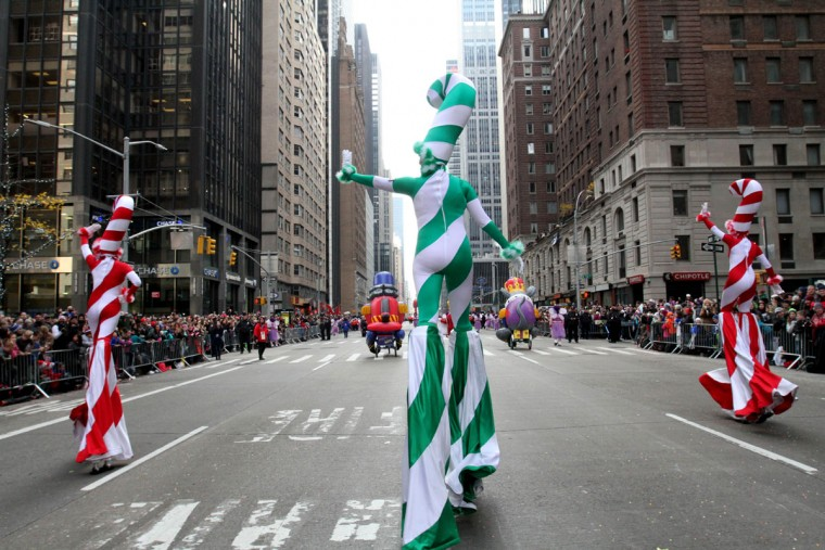 Parade participants dressed as candy canes make their way down New York's Sixth Avenue during the Macy's Thanksgiving Day Parade Thursday, Nov. 26, 2015. (AP Photo/Tina Fineberg)