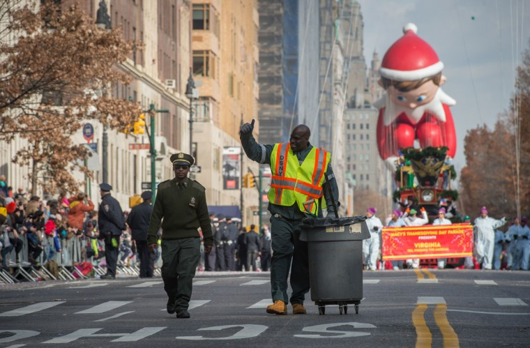A Department of Sanitation worker acknowledges the crowd during the Macy's Thanksgiving Day Parade, Thursday, Nov. 26, 2015 in New York. (AP Photo/Bryan R. Smith)