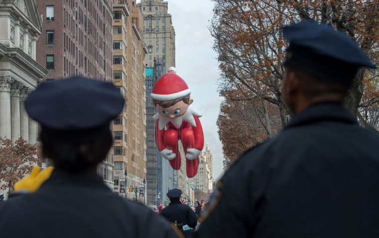 Police officers watch the Macy's Thanksgiving Day Parade, Thursday, Nov. 26, 2015, in New York. (AP Photo/Bryan R. Smith)