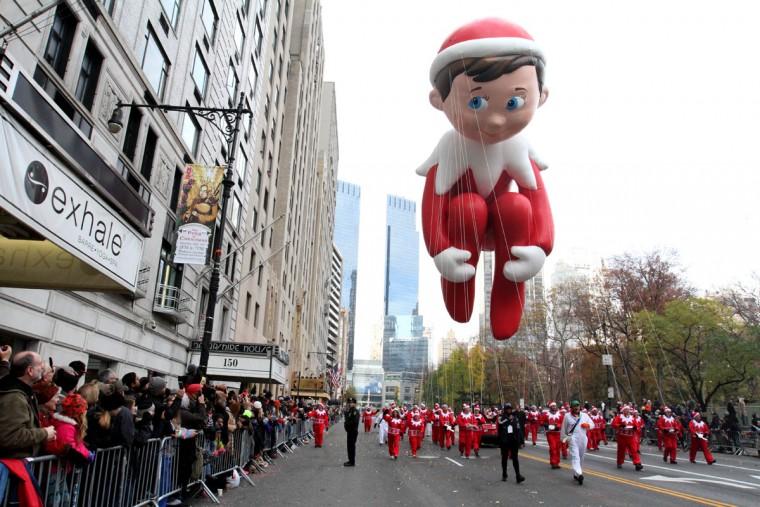The Elf on the Shelf balloon makes its way across New York's Central Park South during the Macy's Thanksgiving Day Parade, Thursday Nov. 26, 2016. (AP Photo/Tina Fineberg)
