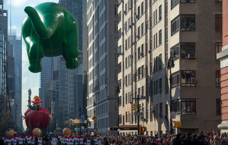 The balloon Dino is moved down Central Park West during the Macy's Thanksgiving Day Parade, Thursday, Nov. 26, 2015, in New York. (AP Photo/Bryan R. Smith)