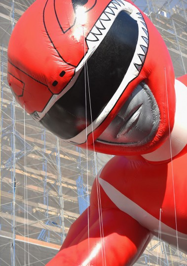 """The Red Ranger from """"Mighty Morphin Power Rangers"""" balloon floats through the parade route during the 89th Annual Macy's Thanksgiving Day Parade on November 26, 2015 in New York City. (Photo by Michael Loccisano/Getty Images)"""