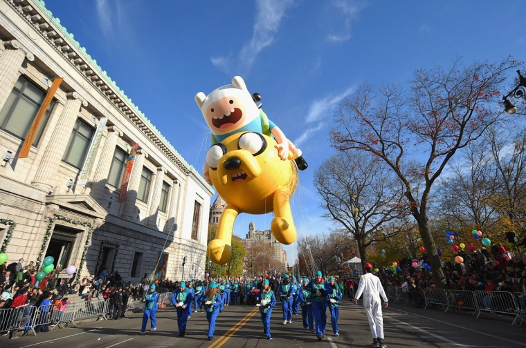 """The Jake and Finn from """"Adventure Time with Finn and Jake"""" balloon floats through the parade route during the 89th Annual Macy's Thanksgiving Day Parade on November 26, 2015 in New York City. (Photo by Michael Loccisano/Getty Images)"""