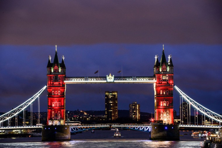 As the sun sets, Tower Bridge is lit up in a succession of blue, white and red representing the French flag on November 14, 2015 in London, England. (Photo by Chris Ratcliffe/Getty Images)