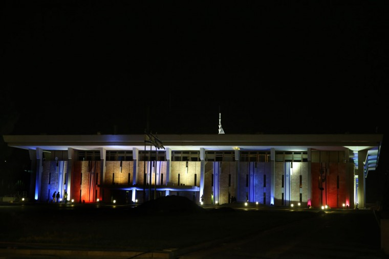 The Knesset, Israel's Parliament in Jerusalem, is illuminated in the colors of the French flag, red, white and blue on November 14, 2015. to show solidarity with France. (GALI TIBBON/AFP/Getty Images)