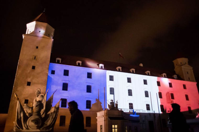 Bratislava Castle is lit in red, white and blue, the colors of the French flag, in Bratislava on November 14, 2015, as Slovakians express their solidarity with France following the coordinated terrorist attacks that left at least 128 dead and 180 injured in Paris late on November 13. (VLADIMIR SIMICEK/AFP/Getty Images)