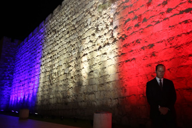 The Mayor of Jerusalem, Nir Barkat, stands in front of Jerusalem's Old City Ottoman Walls illuminated in red, white and blue, the colors of the French flag, in Jerusalem on November 15, 2015 in solidarity with France and the attacks in Paris. Islamic State jihadists claimed a series of coordinated attacks by gunmen and suicide bombers in Paris that killed at least 129 people in scenes of carnage at a concert hall, restaurants and the national stadium Paris. (GALI TIBBON/AFP/Getty Images)