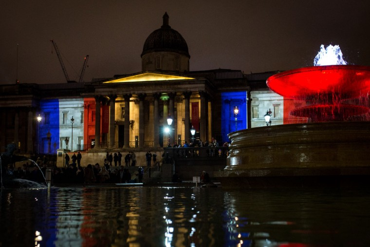 The National Gallery is illuminated with the color of the French flag on November 14, 2015 in London, England. Several landmarks across London have lit with the red, white and blue of France's tricolor flag in tribute to the French people following Friday's terrorist attacks. (Photo by Rob Stothard/Getty Images)