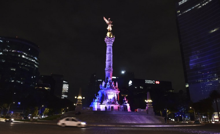 Mexican Independence Angel square is illuminated with the red, white and blue colors of the French national flag in solidarity with France on November 13, 2015, in Mexico City, after attackers killed at least 120 people in Paris. (YURI CORTEZ/AFP/Getty Images)