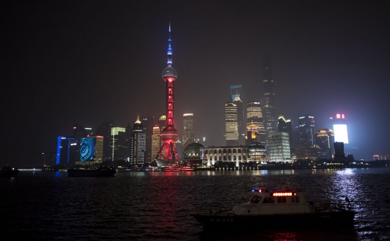 The Oriental Pearl TV Tower in the Lujiazui Financial District in Pudong, is lit in red, white and blue, resembling the colors of the French flag, in Shanghai on November 14, 2015, as the Chinese expressed their solidarity with France following a spate of coordinated attacks that left 128 dead and 180 injured in Paris late on November 13. (JOHANNES EISELE/AFP/Getty Images)
