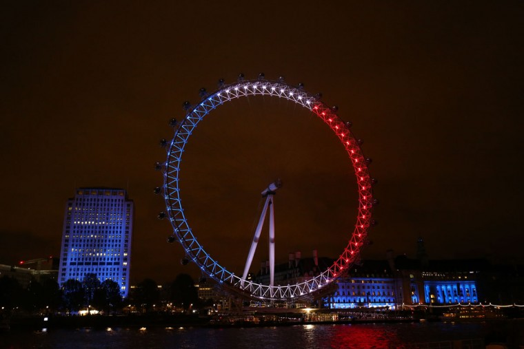 The London Eye is illuminated in blue, white and red lights, resembling the colors of the French national flag, in London on November 14, 2015, as Britons express their solidarity with France following a spate of coordinated attacks that left 128 dead in Paris on November 13. (JUSTIN TALLIS/AFP/Getty Images)