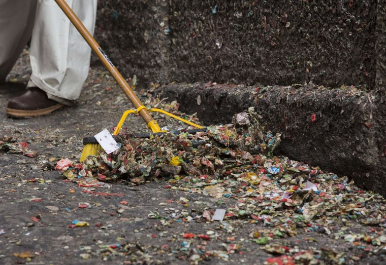 A worker sweeps up some of the 20-years worth of chewing gum that is being removed in Post Alley at the Pike Place Market in Seattle, Washington on November 11, 2015. (JASON REDMOND/AFP/Getty Images)