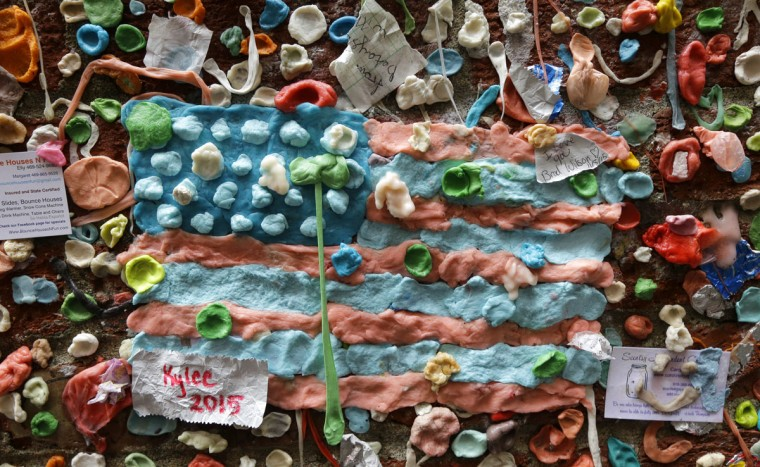 A United States flag made from pieces of gum is shown on a wall at Seattle's famous gum wall at Pike Place Market, Monday, Nov. 9, 2015. (AP Photo/Ted S. Warren)