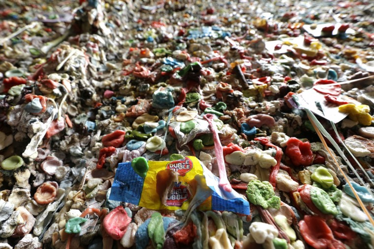 Layers of gum are shown covering a wall at Seattle's famous gum wall at Pike Place Market, Monday, Nov. 9, 2015. (AP Photo/Ted S. Warren)