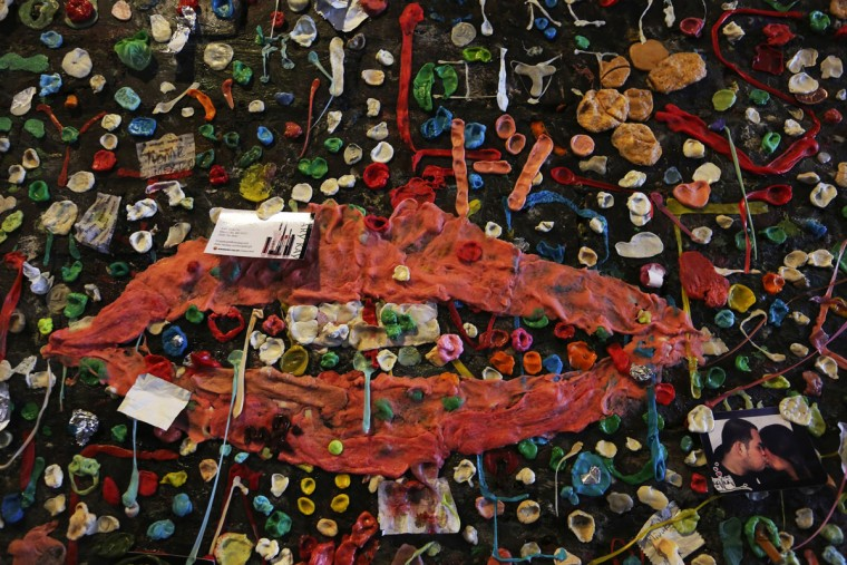 Evoking lips by Man Ray, many pieces of gum went into this attachment to Post Alley's Gum Wall, to be cleaned in a week, in Seattle on Tuesday, Nov. 3, 2015. (Alan Berner/Seattle Times/TNS)