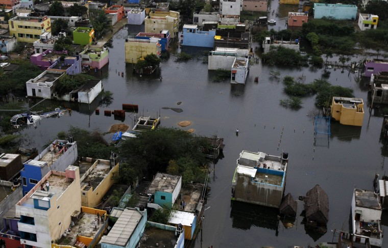 A residential area is seen surrounded by floodwaters in Chennai, India, Saturday, Dec. 5, 2015. Although floodwaters have begun to recede, vast swaths of Chennai and neighboring districts were still under 2 1/2 to 3 meters (8 to 10 feet) of water, with tens of thousands of people in state-run relief camps. (AP Photo/Arun Sankar K)
