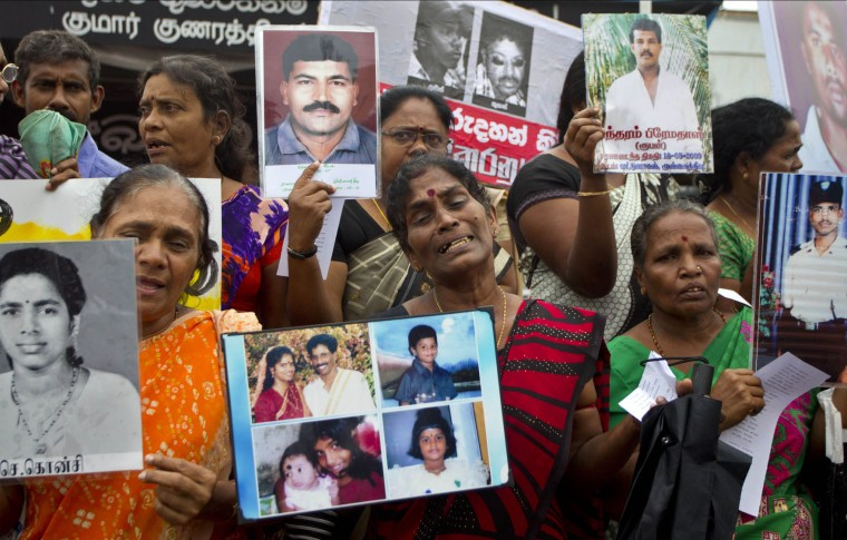 Sri Lankan ethnic Tamil women hold photographs of their family members who have gone missing, during a protest to mark international Human Rights Day in Colombo, Sri Lanka, Thursday, Dec. 10, 2015. The protesters urged the government to investigate as they alleged that the government forces were behind the disappearances. (AP Photo/Eranga Jayawardena)
