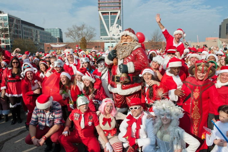 A crowd of people dressed as Santa gather for a group photo during the annual SantaCon pub crawl December 12, 2015 in the Brooklyn borough of New York City. Hundreds of revelers take part in the holiday pub crawl, though some local bars and businesses have banned participants in an effort to avoid the typically rowdy SantaCon crowds. (Stephanie Keith/Getty Images)
