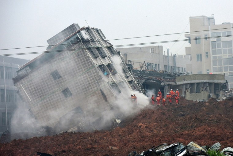 Rescuers search for survivors on a collapsed building following a landslide in Shenzhen, in south China's Guangdong province, Sunday, Dec. 20, 2015. (Chinatopix via AP)