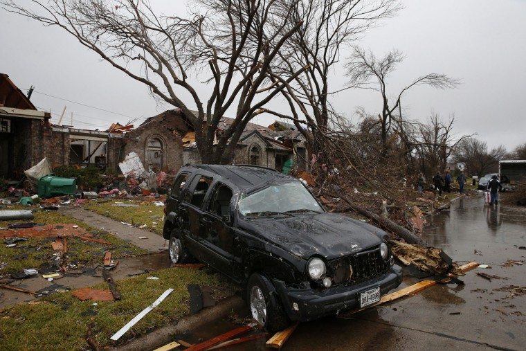 A Jeep Liberty sits destroyed on Shipman Street in Rowlett, Texas, on Sunday, Dec. 27, 2015, after a tornado hit the area the night before. (Nathan Hunsinger/Dallas Morning News/TNS)