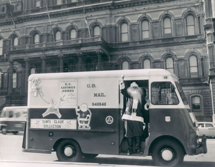 Albert Magowski, dressed as Santa Claus, waves from a mail truck in front of City Hall. (Walter McCardell/Baltimore Sun, 1959)