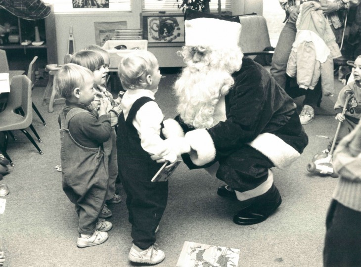 "Santa, aka Phillip Bundy III, president of the non-profit ""Children Favorite Things,"" visits the Up County Family Support Center where he was guest of honor at the Christmas party and distributed gifts for kids to unwrap on Christmas. (Barbara Haddock/Baltimore Sun, 1991)"