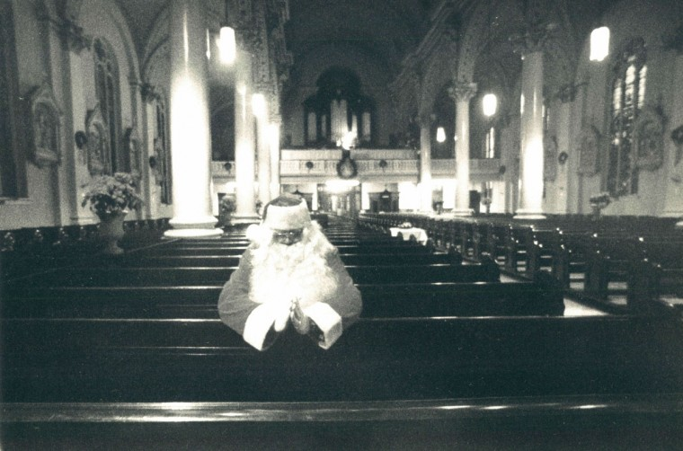 Santa has a respite at St. Michael Church at Lombard and Wolfe after delivering toys to be distributed to the needy at the church rectory. (Jed Kirschbaum/Baltimore Sun, 1986)