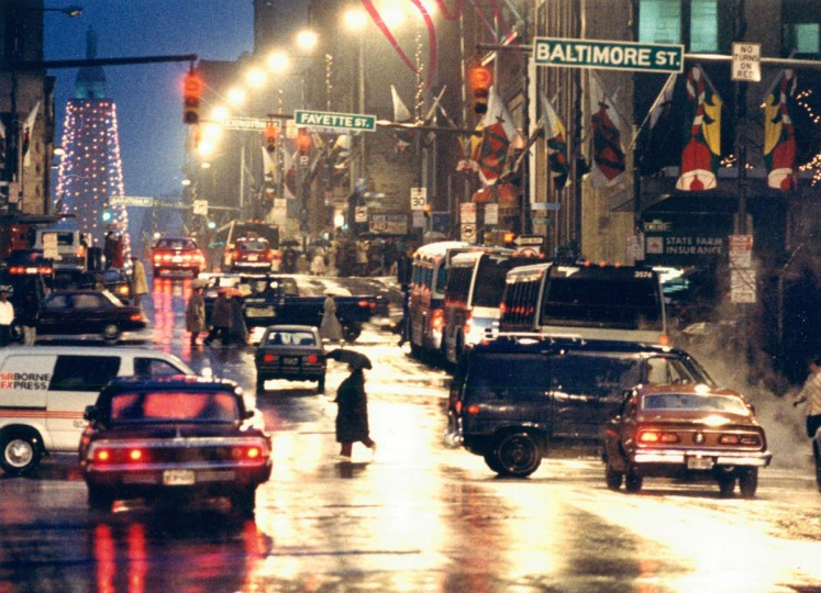 Rush hour traffic and the Washington Monument combine to produce a pretty reflection in the rain at dusk. (Irving Phillips, Jr./Baltimore Sun, 1986)