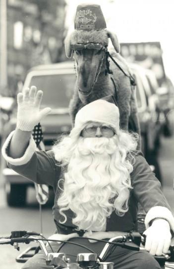 John Davis of the West Baltimore Christian Warriors dresses as Santa for the Hampden Christmas parade. (Jed Kirschbaum/Baltimore Sun, 1990)