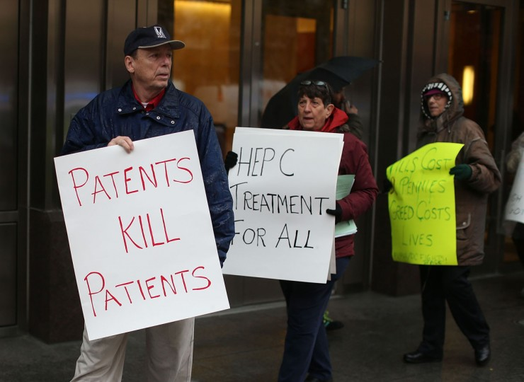 Activist with the Washington Peace Center protest in front of the offices of PhRMA, Pharmaceutical Research and Manufacturers of America, December 1, 2015 in Washington, DC. The activists were protesting against the high price of PhRMA's drugs, on World AIDS Day. (Photo by Mark Wilson/Getty Images)