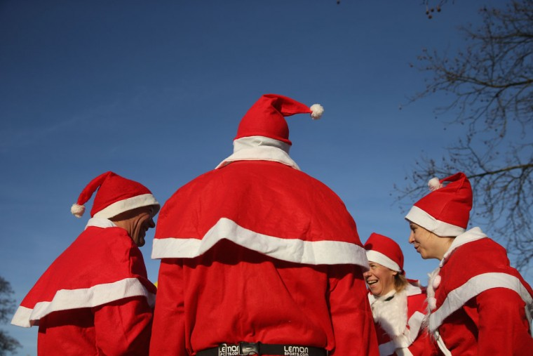 Participants dressed as Santa Claus wait to start in the 7th annual Michendorf Santa Run on December 6, 2015 in Michendorf, Germany. A record 900 runners took part in this year's event, which included 2,5km, 5km and 10km races. (Photo by Sean Gallup/Getty Images)